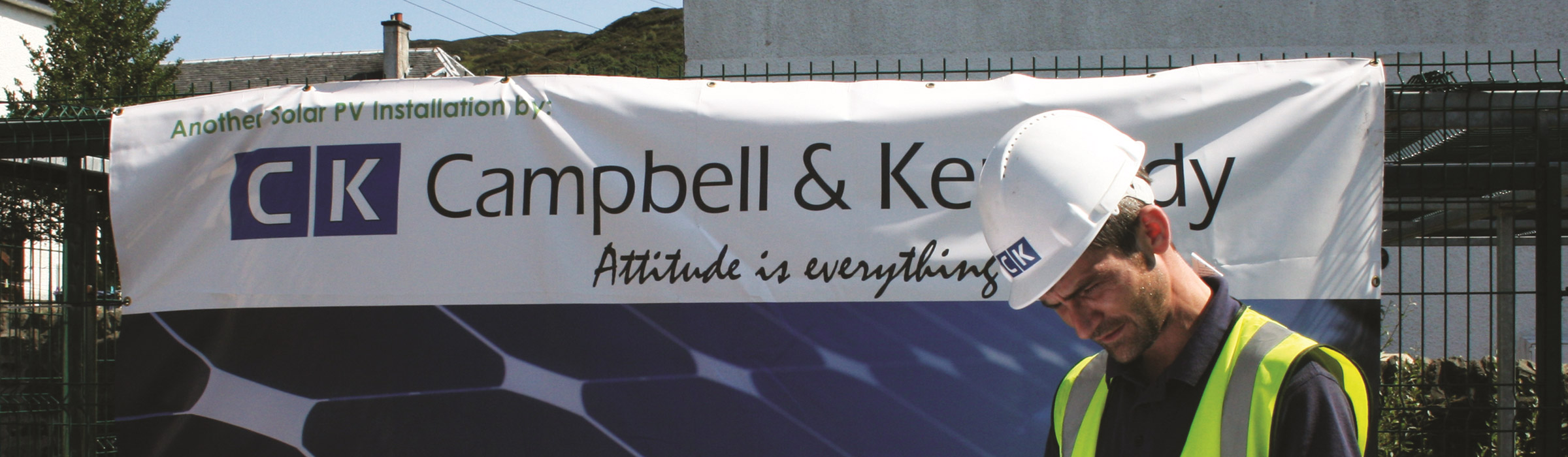 Campbell Kennedy signage with worker